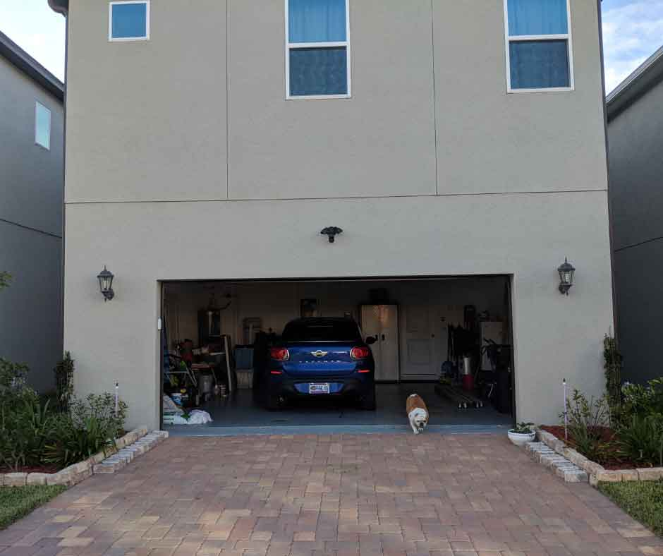 Attached garage with living space above it